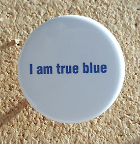 'I am true blue' button on corkboard